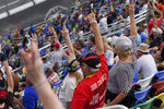 Fans hold up three fingers during a lap three tribute honoring the late Dale Earnhardt, Sr., during the NASCAR Daytona 500 auto race at Daytona International Speedway, Sunday, Feb. 14, 2021, in Daytona Beach, Fla. Dale Earnhardt, Sr., the all-time winner at Daytona, was killed in a fatal car crash at the speedway 20-years ago today. (AP Photo/Chris O'Meara)