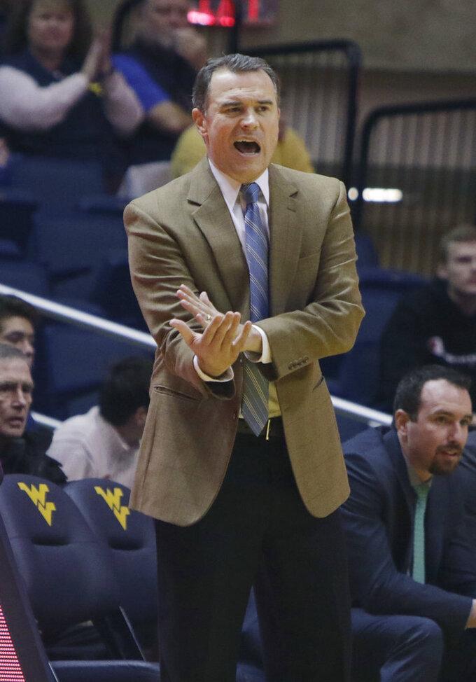 Lehigh head coach Brett Reed yells for a foul call during the first half of an NCAA college basketball game against West Virginia, Sunday, Dec. 30, 2018, in Morgantown, W.Va. (AP Photo/Raymond Thompson)