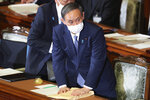 Japanese Prime Minister Yoshihide Suga attends an extraordinary Diet session to deliver his policy speech at the upper house of parliament in Tokyo, Monday, Oct. 26, 2020. Suga has declared Japan will achieve zero carbon emissions by 2050 in his first policy speech after taking over from Shinzo Abe. The policy speech Monday at the outset of the parliamentary session set an ambitious agenda reflecting Suga's pragmatic approach to getting things done. (AP Photo/Koji Sasahara)