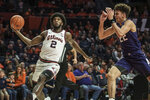 Illinois' Kipper Nichols (2) goes in for a lay up as Northwestern's Pete Nance (22) looks to defend in the first half of an NCAA college basketball game, Saturday Jan. 18, 2020, in Champaign, Ill. (AP Photo/Holly Hart)