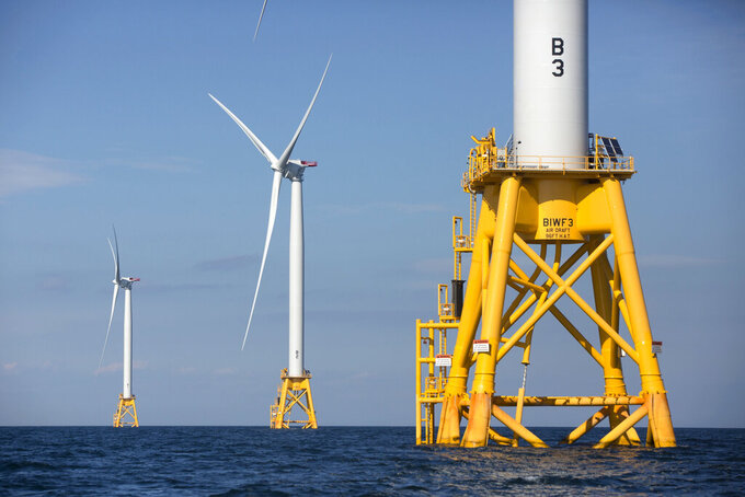 FILE - In this Monday, Aug. 15, 2016, file photo, three of Deepwater Wind's turbines stand in the water off Block Island, R.I. A huge wind farm off the Massachusetts coast is edging closer to federal approval, setting up what the Biden administration hopes will be a model for a sharp increase in offshore wind energy development along the East Coast.(AP Photo/Michael Dwyer, File)