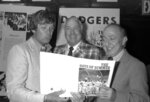 FILE - In this June 24, 1982, file photo, author Roger Kahn, right, joins former Brooklyn Dodger outfielder Duke Snider, center, and former Dodger pitcher, Clem Labine, at the start of production on the television film based on Kahn's best selling book,