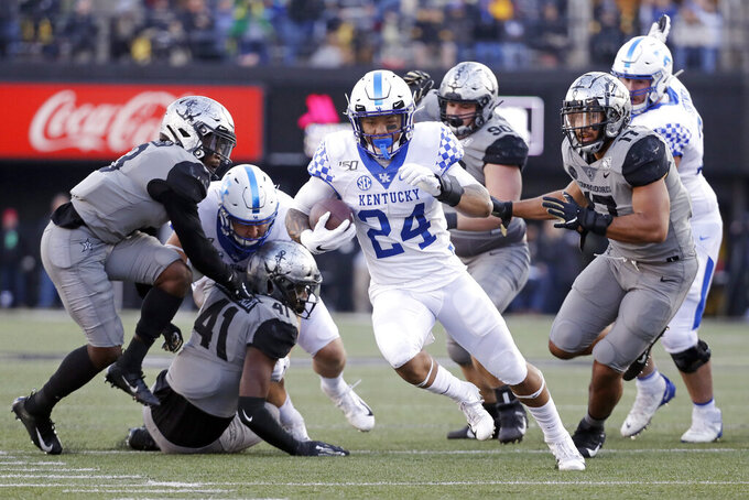 Kentucky running back Christopher Rodriguez Jr. (24) runs 22 yards for a touchdown against Vanderbilt in the first half of an NCAA college football game Saturday, Nov. 16, 2019, in Nashville, Tenn. (AP Photo/Mark Humphrey)