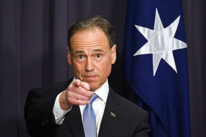 Australia's Health Minister Greg Hunt speaks to the media during a press conference at Parliament House in Canberra, Thursday, May 13, 2021. Australia has reached a supply agreement for 25 million doses of Moderna COVID-19 vaccines. (Lukas Coch/AAP Image via AP)