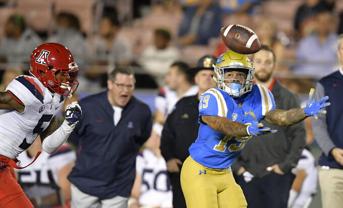 UCLA running back Kazmeir Allen, right, can't hold on to a pass as Arizona safety Christian Young defends during the first half of an NCAA college football game, Saturday, Oct. 20, 2018, in Pasadena, Calif. (AP Photo/Mark J. Terrill)