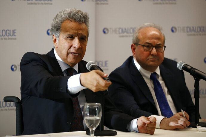 Ecuador's President Lenin Moreno, left, speaks at an event at the Inter-American Dialogue think tank, Tuesday, April 16, 2019, in Washington. (AP Photo/Patrick Semansky)