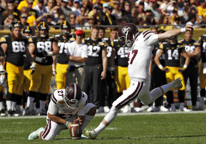 Mississippi State' Jace Christmann (47) kicks a field goal against Iowa during the first half of the Outback Bowl NCAA college football game Tuesday, Jan. 1, 2019, in Tampa, Fla. Holding is Kody Schexnayder (27) (AP Photo/Chris O'Meara)