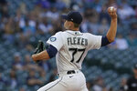 Seattle Mariners starting pitcher Chris Flexen throws against the Oakland Athletics during the first inning of a baseball game, Thursday, July 22, 2021, in Seattle. (AP Photo/Ted S. Warren)
