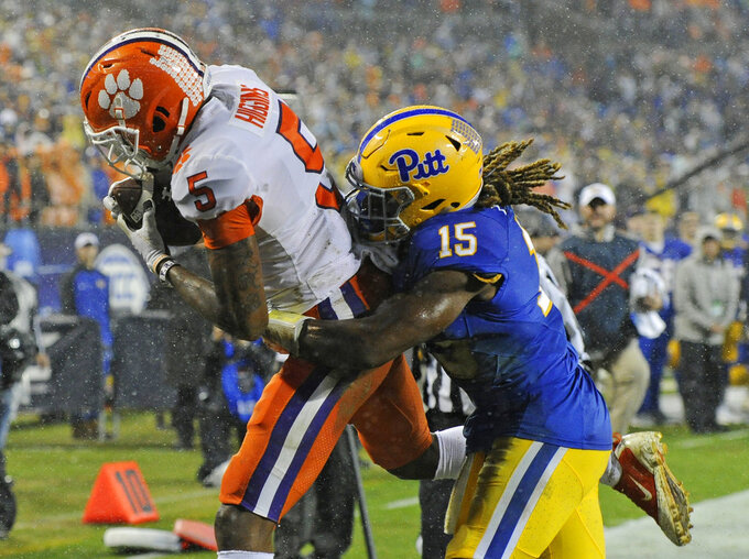 Clemson's Tee Higgins (5) catches a touchdown pass as Pittsburgh's Jason Pinnock (15) defends in the first half of the Atlantic Coast Conference championship NCAA college football game in Charlotte, N.C., Saturday, Dec. 1, 2018. (AP Photo/Mike McCarn)