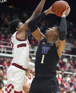 Washington forward Nate Roberts (1) shoots over Stanford guard Bryce Wills (2) during the first half of an NCAA college basketball game Thursday, Jan. 9, 2020, in Stanford, Calif. (AP Photo/Tony Avelar)