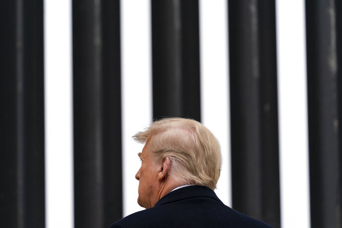 President Donald Trump tours a section of the U.S.-Mexico border wall, Tuesday, Jan. 12, 2021, in Alamo, Texas. (AP Photo/Alex Brandon)