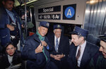 FILE - In this Feb. 18, 1992, file photo, jazz great Cab Calloway, center, jokes with New York City Mayor David Dinkins, left, and Grammy organizer Jonathan Tisch while riding a specially designated subway train from Harlem to Radio City Music Hall as part of the Grammy Week festivities in New York. New York's subway system was immortalized in the Duke Ellington classic
