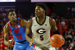 Georgia's Anthony Edwards (5) moves the ball past Mississippi guard Bryce Williams (13) during an NCAA college basketball game in Athens, Ga., Saturday, Jan. 25, 2020. (Joshua L. Jones/Athens Banner-Herald via AP)