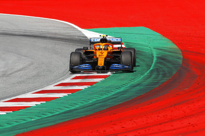 Mclaren driver Lando Norris of Britain steers his car during the Austrian Formula One Grand Prix at the Red Bull Ring racetrack in Spielberg, Austria, Sunday, July 5, 2020. (Leonhard Foeger/Pool via AP)