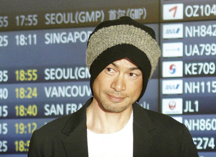 Seattle Mariners' Ichiro Suzuki smiles upon his team's arrival at Haneda international airport in Tokyo Friday, March 15, 2019. The Mariners will play in a two-baseball game series against the Oakland Athletics to open the Major League season on March 20-21 at the Tokyo Dome. (AP Photo/Eugene Hoshiko)