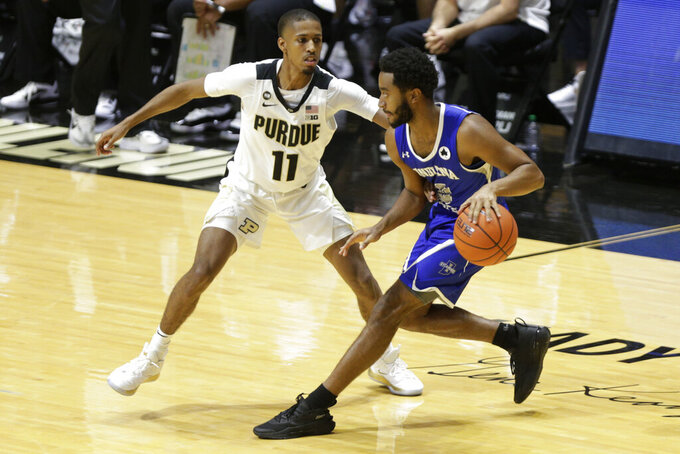 Indiana State guard Cam Bacote (0) is defended by Purdue guard Isaiah Thompson (11) during the first half of an NCAA college basketball game Saturday, Dec. 12, 2020, in West Lafayette, Ind. (Nikos Frazier/Journal & Courier via AP)