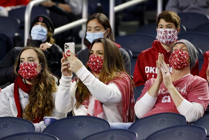 Oklahoma fans watch the team play Florida in the first half of the Cotton Bowl NCAA college football game in Arlington, Texas, Wednesday, Dec. 30, 2020. (AP Photo/Michael Ainsworth)