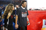 Tampa Bay Buccaneers quarterback Tom Brady (12) walks with his wife, Gisele Bündchen, following the NFL Super Bowl 55 football game against the Kansas City Chiefs, Sunday, Feb. 7, 2021, in Tampa, Fla. Tampa Bay won 31-9 to win Super Bowl LV. (Ben Liebenberg via AP)