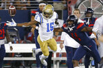 CORRECTS MONTH TO SEPTEMBER INSTEAD OF OCTOBER - Arizona cornerback Christian Roland-Wallace defends the pass intended for UCLA wide receiver Jaylen Erwin (15) in the first half of an NCAA college football game, Saturday, Sept. 28, 2019, in Tucson, Ariz. (AP Photo/Rick Scuteri)