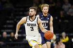 Iowa guard Jordan Bohannon (3) drives up court ahead of North Florida forward Josh Endicott, right, during the first half of an NCAA college basketball game, Thursday, Nov. 21, 2019, in Iowa City, Iowa. (AP Photo/Charlie Neibergall)
