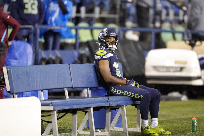 Seattle Seahawks' Tyler Lockett sits on the bench after his team lost to the New Orleans Saints in an NFL football game, Monday, Oct. 25, 2021, in Seattle. (AP Photo/Ted S. Warren)