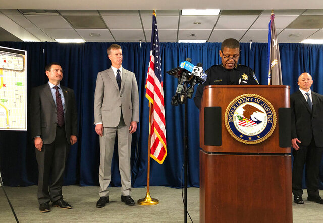 San Francisco Police Chief William Scott, speaking at the podium, joins Federal authorities announcing, Friday, March 13, 2020, indictments against 17 alleged members and associates of the MS-13 gang, saying they were trying to take over San Francisco's Mission neighborhood. Homeland Security Investigations special agent in charge Tatum King, left and second from left is U.S. Attorney for Northern California David Anderson. (AP Photo/Janie Har)