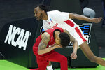 Rutgers' Jacob Young, bottom, covers his face after colliding with Houston's DeJon Jarreau, top, during the first half of a college basketball game in the second round of the NCAA tournament at Lucas Oil Stadium in Indianapolis Sunday, March 21, 2021. (AP Photo/Mark Humphrey)