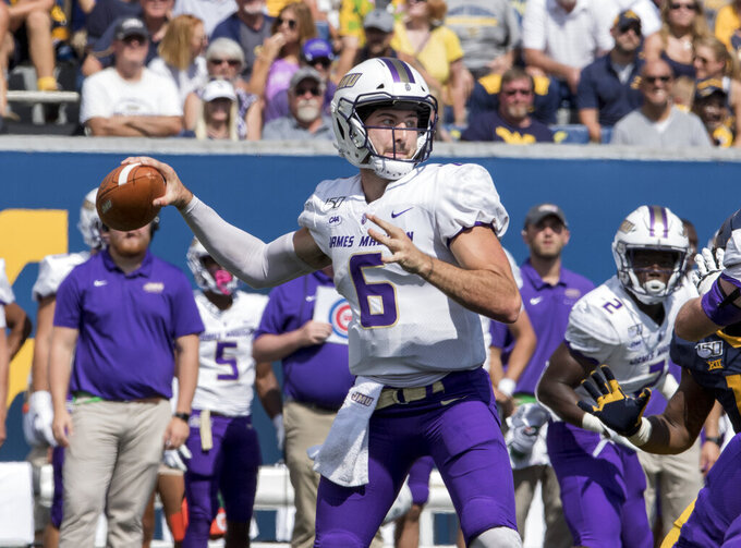 James Madison quarterback Ben DiNucci (6) attempt a pass during the first half of an NCAA college football game Saturday, Aug. 31, 2019, in Morgantown, W.Va. (AP Photo/Raymond Thompson)