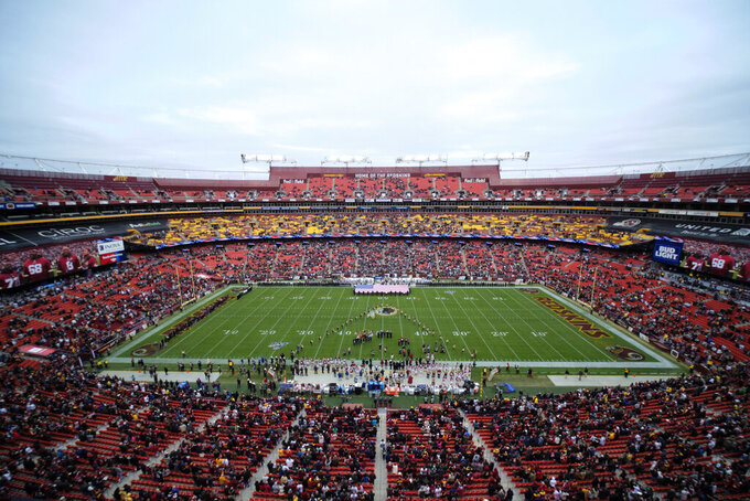 FILE - In this Nov. 17, 2019, file photo, FedEx Field is seen in this general view during the National Anthem prior to an NFL football game between the New York Jets and Washington Redskins, in Landover, Md. There were more than 20,000 empty seats for the Redskins' last home game, and when many of them have been filled this season, it's with fans of the visiting team. It could be even emptier Sunday when the 1-9 Redskins host the 3-6-1 Detroit Lions. (AP Photo/Mark Tenally, File)
