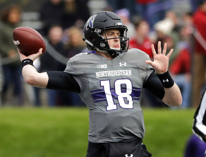 Northwestern quarterback Clayton Thorson looks to pass against Northwestern during the first half of an NCAA college football game in Evanston, Ill., Saturday, Oct. 27, 2018. (AP Photo/Nam Y. Huh)