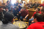 Drummers welcome representatives from South Dakota's nine Indian tribes to the state Capitol as Crow Creek Sioux Chairman Lester Thompson delivers the State of the Tribes address Thursday, Jan. 16, 2020 at the state Capitol in Pierre, S.D. (AP Photo/Stephen Groves)