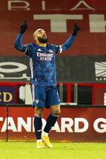 Arsenal's Alexandre Lacazette celebrates after scoring his side's third goal during the English Premier League soccer match between Sheffield United and Arsenal at the Bramall Lane stadium in Sheffield, England, Sunday, April 11, 2021. (AP Photo/Tim Keeton, Pool)