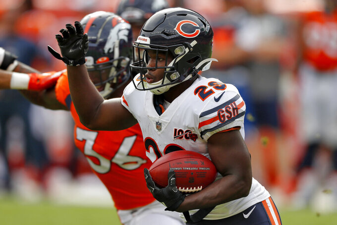 Chicago Bears running back Tarik Cohen (29) runs the ball against the Denver Broncos during the first half of an NFL football game, Sunday, Sept. 15, 2019, in Denver. (AP Photo/David Zalubowski)