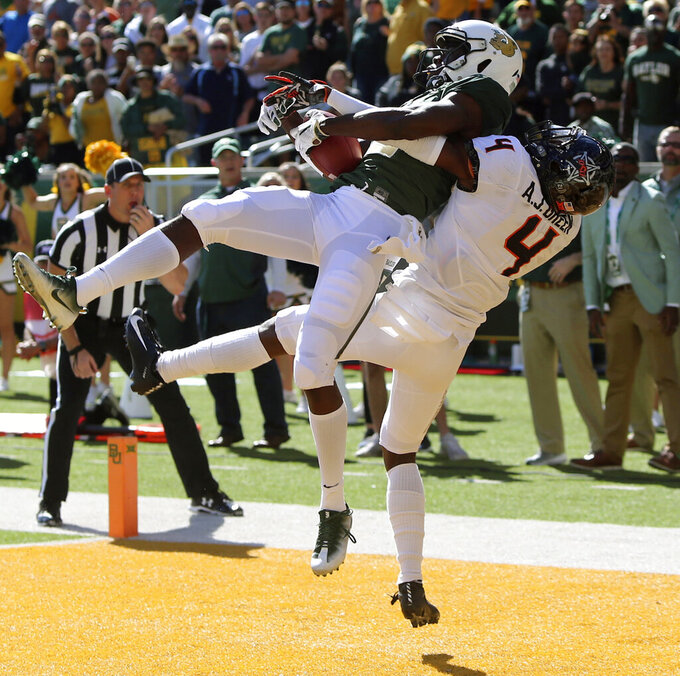 FILE - In this Nov. 3, 2018, file photo, Baylor's wide receiver Denzel Mims, left, pulls down the game winning touchdown over Oklahoma State's cornerback A.J. Green, right, in the second half of an NCAA college football game in Waco, Texas. Mims is a possible pick in the NFL Draft which runs Thursday, April 23, 2020 thru Saturday, April 25. (Michael Bancale/Waco Tribune-Herald via AP, File)