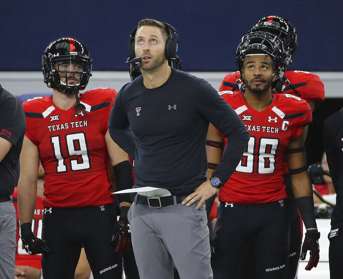 Texas Tech coach Kliff Kingsbury looks up to the video board in the second half of the team's NCAA college football game against Baylor on Saturday, Nov. 24, 2018, in Arlington, Texas. (Jerry Larson/Waco Tribune Herald, via AP