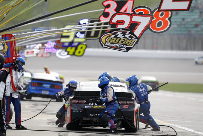 Chris Buescher (37) pits during a NASCAR Cup Series auto race at Kansas Speedway in Kansas City, Kan., Sunday, Oct. 20, 2019. (AP Photo/Colin E. Braley)