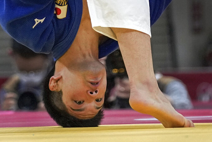 Shohei Ono of Japan, looks as he competes with Alexandru Raicu of Romania during their men's -73kg elimination round of the judo match at the 2020 Summer Olympics in Tokyo, Japan, Monday, July 26, 2021. (AP Photo/Vincent Thian)