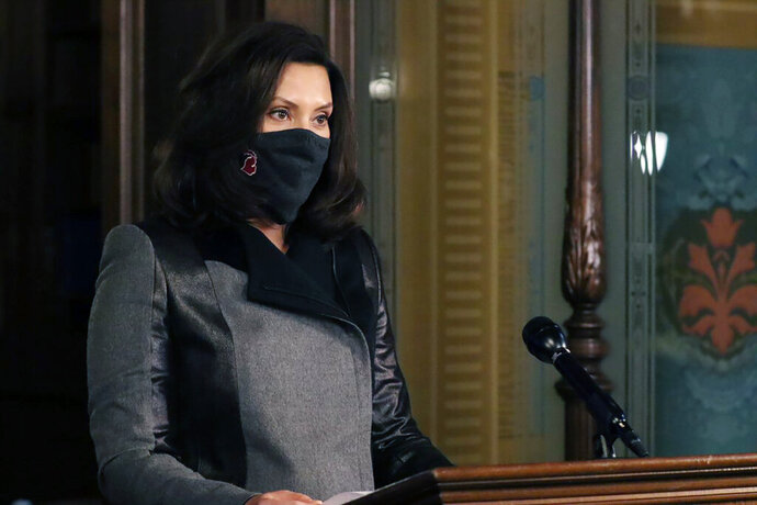 In this photo provided by the Michigan Office of the Governor, Michigan Gov. Gretchen Whitmer addresses the state during a speech in Lansing, Mich., Wednesday, Oct. 21, 2020. The governor is warning that Michigan has more confirmed cases of the coronavirus than ever, noting a sharp increase since the state Supreme Court invalidated her sweeping orders earlier this month. Since the court decision on Oct. 2, the seven-day case average is up to 1,818 — nearly double. (Michigan Office of the Governor via AP)