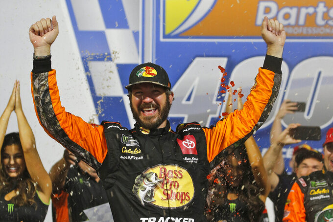 Martin Truex Jr. celebrates his win in the NASCAR Cup Series auto race at Richmond Raceway in Richmond, Va., Saturday, Sept. 21, 2019. (AP Photo/Steve Helber)
