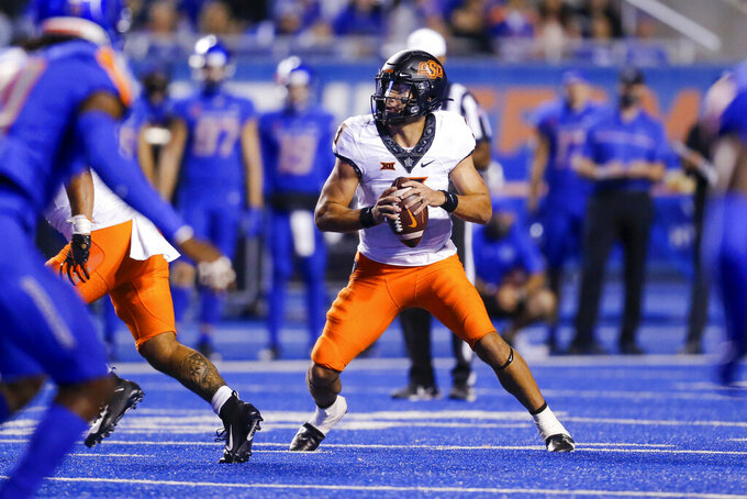 Oklahoma State quarterback Spencer Sanders drop back during the second half of the team's NCAA college football game against Boise State on Saturday, Sept. 18, 2021, in Boise, Idaho. (AP Photo/Steve Conner)