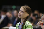 Swedish climate activist Greta Thunberg listens to speeches before addressing a plenary of U.N. climate conference at the COP25 summit in Madrid, Spain, Wednesday, Dec. 11, 2019. Thunberg is in Madrid where a global U.N.-sponsored climate change conference is taking place. (AP Photo/Paul White)