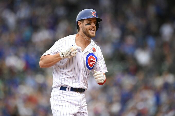 Chicago Cubs' Patrick Wisdom celebrates while rounding third base after hitting a solo home run during the fourth inning of a baseball game against the San Diego Padres, Monday, May 31, 2021, in Chicago. (AP Photo/Paul Beaty)