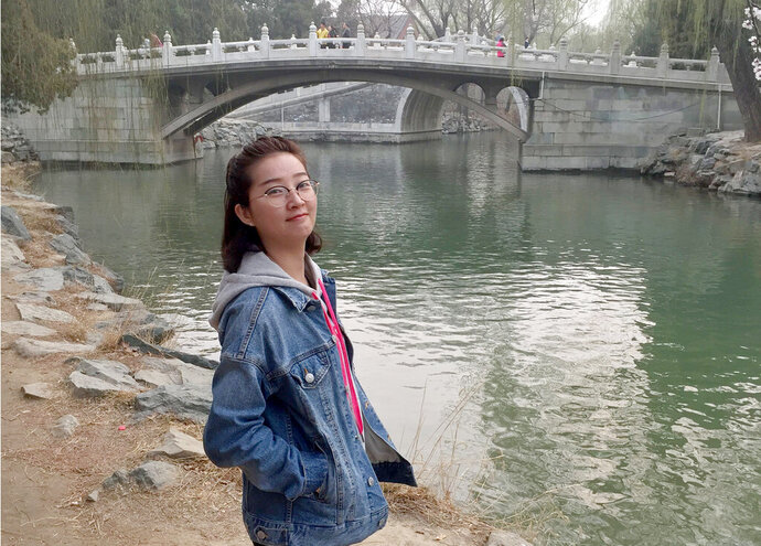 This undated photo provided by the University of Illinois Police Department shows Yingying Zhang. The parents of the visiting University of Illinois scholar who disappeared two years ago have arrived in Illinois from China for the murder trial of the man accused of abducting and killing her.   Former Illinois student Brendt Christensen is charged with  Zheng, whose body hasn't been found. He pleaded not guilty and his trial is set to begin Monday, June 3, 2019. (Courtesy of the University of Illinois Police Department via AP)