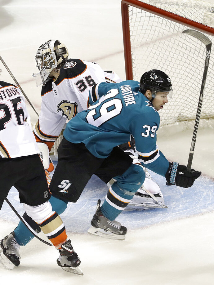 San Jose Sharks center Logan Couture (39) reacts after scoring a goal against Anaheim Ducks goalie John Gibson (36) during the first period of Game 3 of an NHL hockey first-round playoff series in San Jose, Calif., Monday, April 16, 2018. (AP Photo/Jeff Chiu)