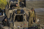 Israeli soldiers sit on top of mobile artillery near the border with Gaza, in southern Israel, Wednesday, March 27, 2019. (AP Photo/Tsafrir Abayov)