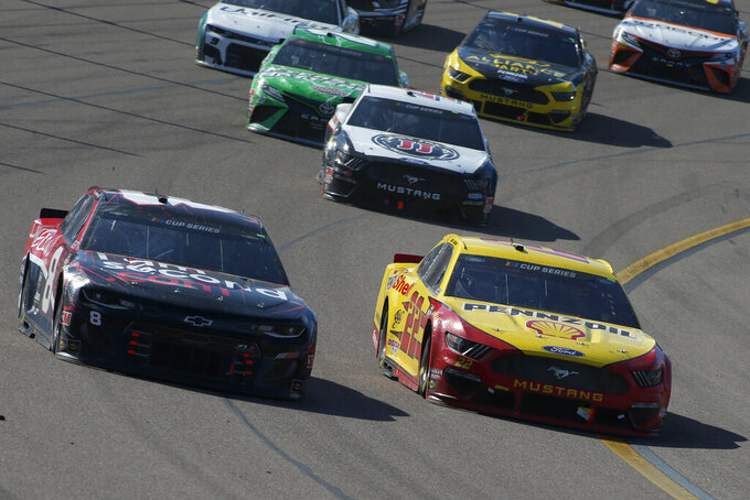 Joey Logano (22) races Tyler Reddick (8) out of Turn 4 during a NASCAR Cup Series auto race at Phoenix Raceway, Sunday, March 8, 2020, in Avondale, Ariz. (AP Photo/Ralph Freso)