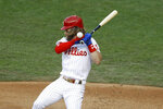 Philadelphia Phillies' Bryce Harper is hit by a pitch from Atlanta Braves' Sean Newcomb during the second inning of a baseball game, Monday, Aug. 10, 2020, in Philadelphia. (AP Photo/Matt Slocum)
