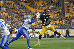 Pittsburgh Steelers quarterback Dwayne Haskins (3) passes over Detroit Lions' Bruce Hector during the second half of an NFL preseason football game, Saturday, Aug. 21, 2021, in Pittsburgh. (AP Photo/Don Wright)