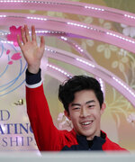 Nathan Chen from the U.S. acknowledges the crowd after he was declared the gold medal winner for the men's free skating routine during the ISU World Figure Skating Championships at Saitama Super Arena in Saitama, north of Tokyo, Saturday, March 23, 2019. (AP Photo/Andy Wong)