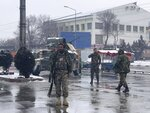 National army soldiers arrive at the site of explosion near the military academy in Kabul, Afghanistan, Tuesday, Feb. 11, 2020. The explosion occurred early Tuesday near the military academy in a southern neighborhood of the Afghan capital, a government spokesman said. (AP Photo/Rahmat Gul)